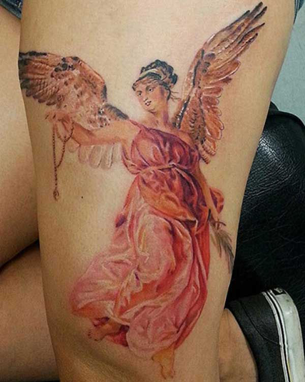 angel tattoo on thigh