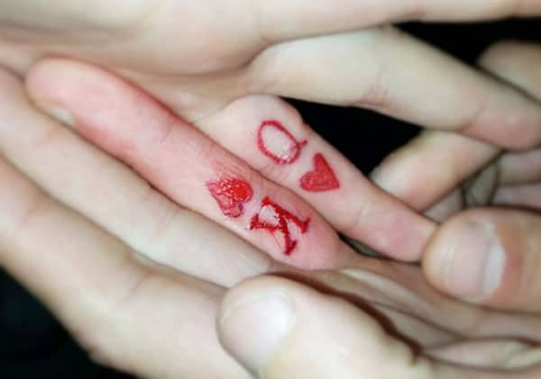 couple finger tattoos
