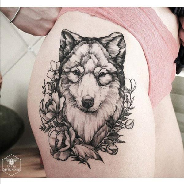 farkas tetoválás a combon