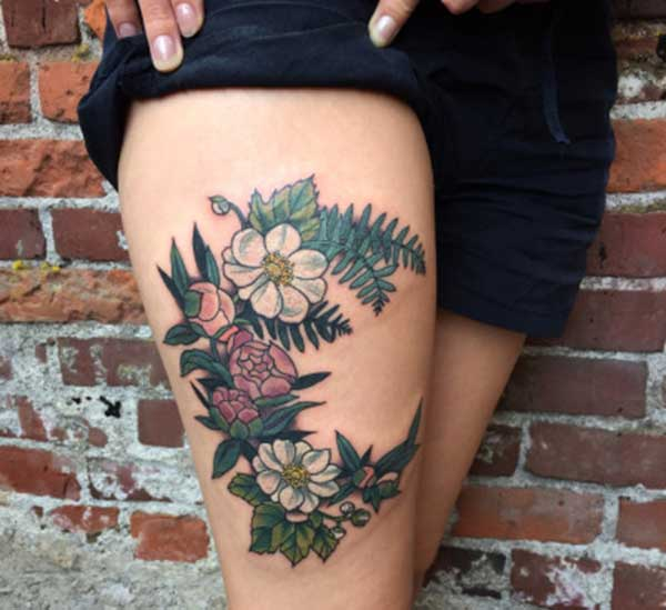 thigh flower tattoos