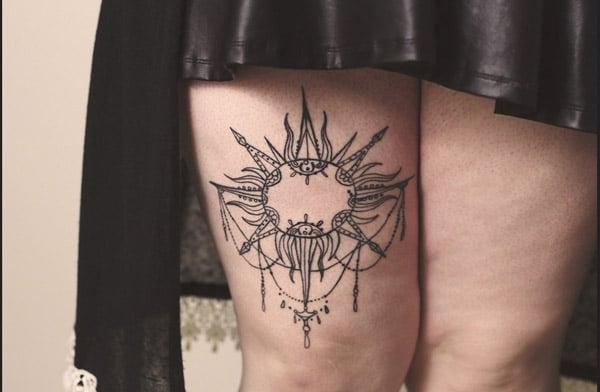 sun tattoo on thigh