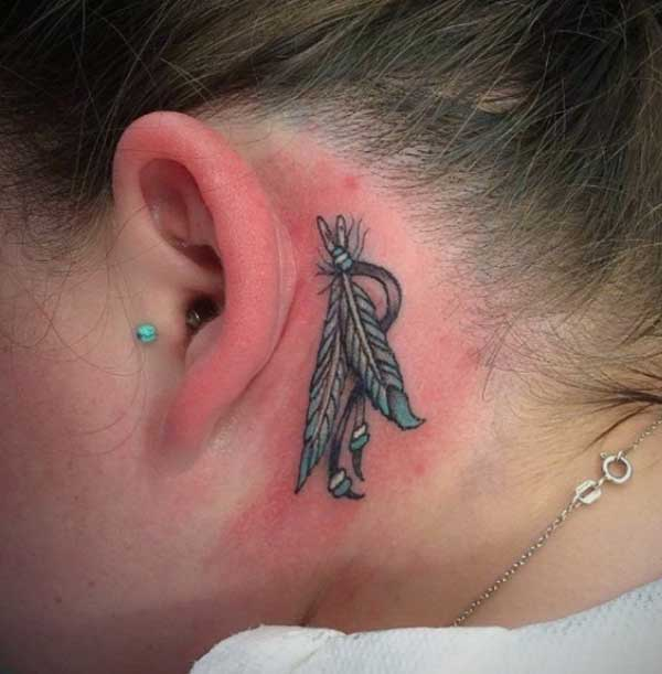 feather behind the ear tattoo