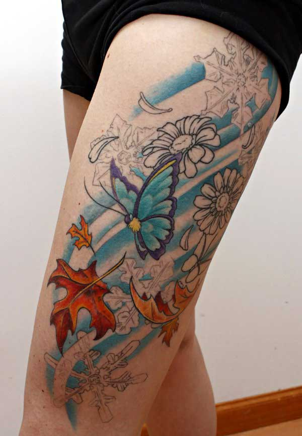 super butterfly thigh tattoo idea for ladies