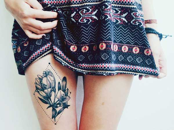 flower tattoo design on girl thigh