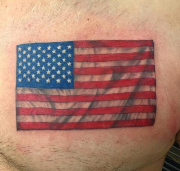 The American Flag Tattoo on the upper chest make a man have a majestic appearance