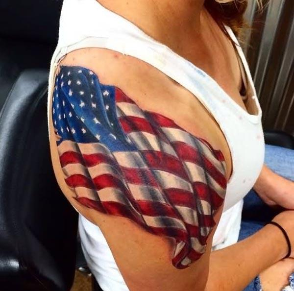 American Flag Tattoo on the right shoulder brings the exquisite look