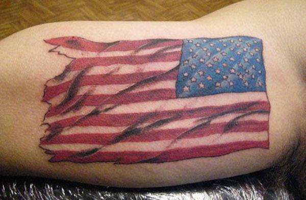 American Flag Tattoo on the front upper arm make a man look splendid