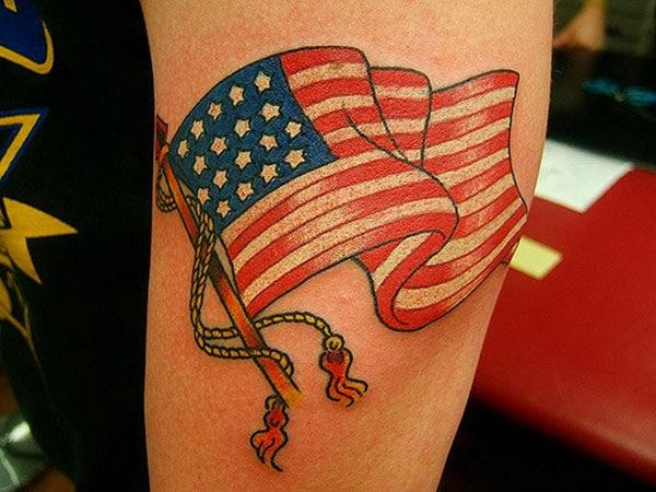 The design ink on this American Flag Tattoo on the elbow makes men have an eye-catching look