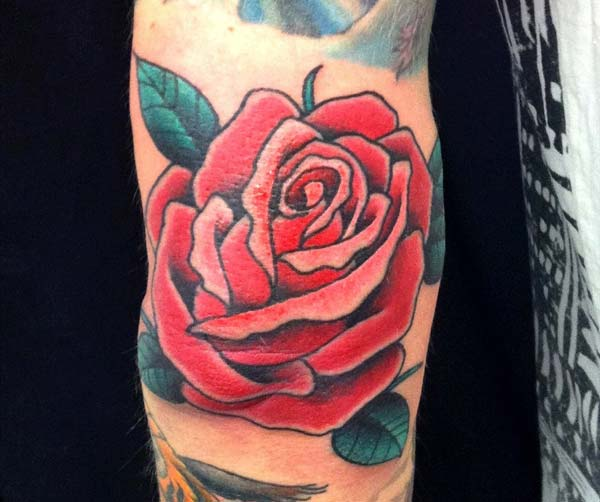 rose tattoo ink idea for men elbow
