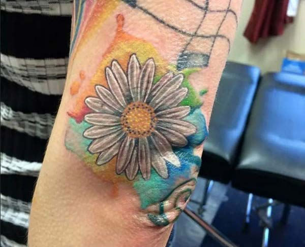 simple and cool sunflower tattoo design on elbow for men