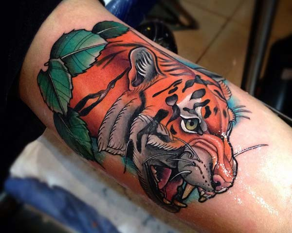 tiger face tattoo design idea on inner elbow