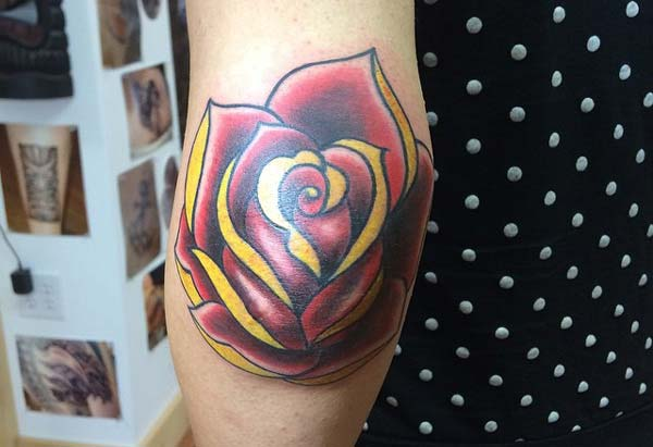 colorful rose elbow tattoo ink idea for women's