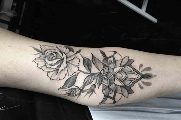 inner elbow flower tattoo design idea for girls