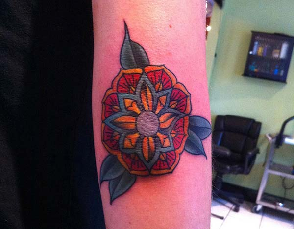 cool flower tattoo with a leafs ink idea for ladies on the elbow