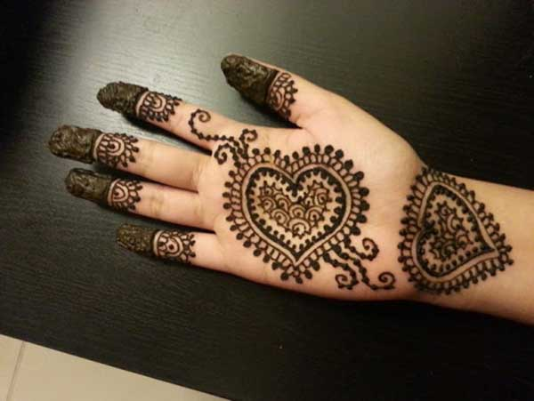 Cute henna mehndi tattoo design on hand