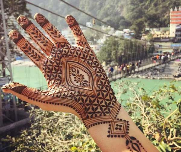 arabic henna mehndi tattoo design on hand