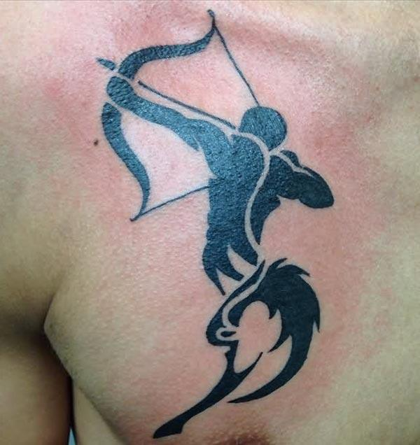 gets a bold look with the black archer Sagittarius tattoo