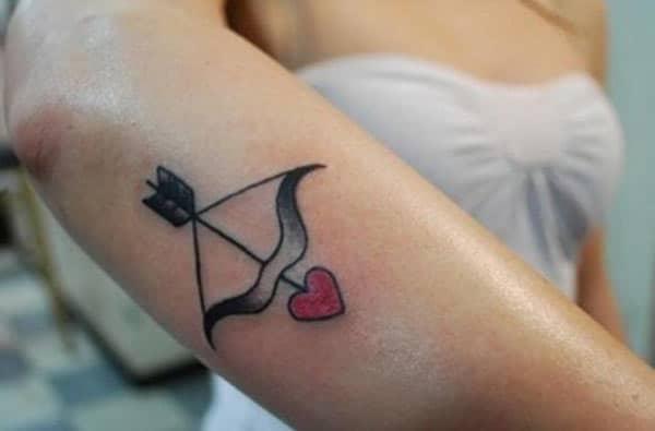 makes the simple pink Sagittarius tattoo on the lower arm