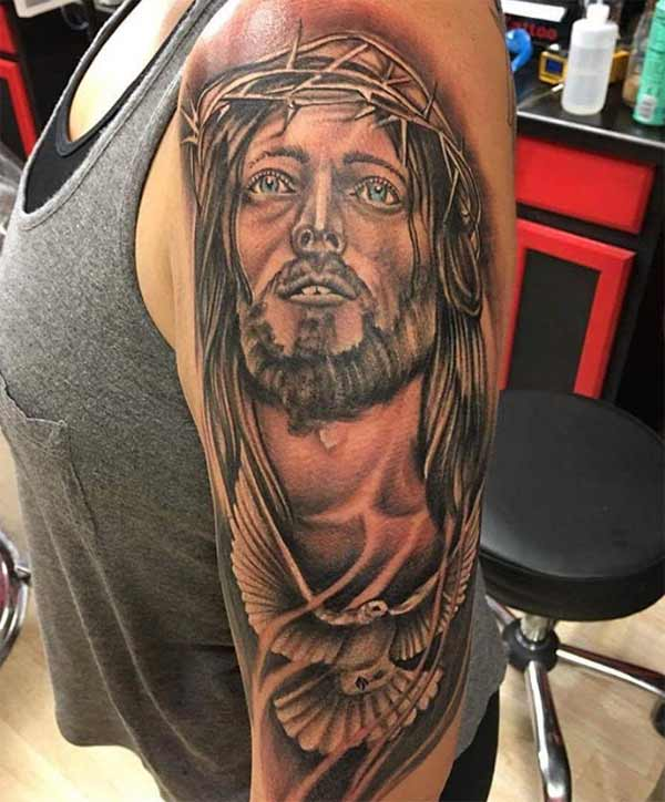 Jesus tattoo ink design idea for female shoulder