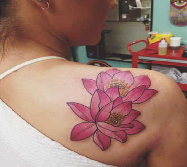 lotus flower tattoo idea on shoulder for women