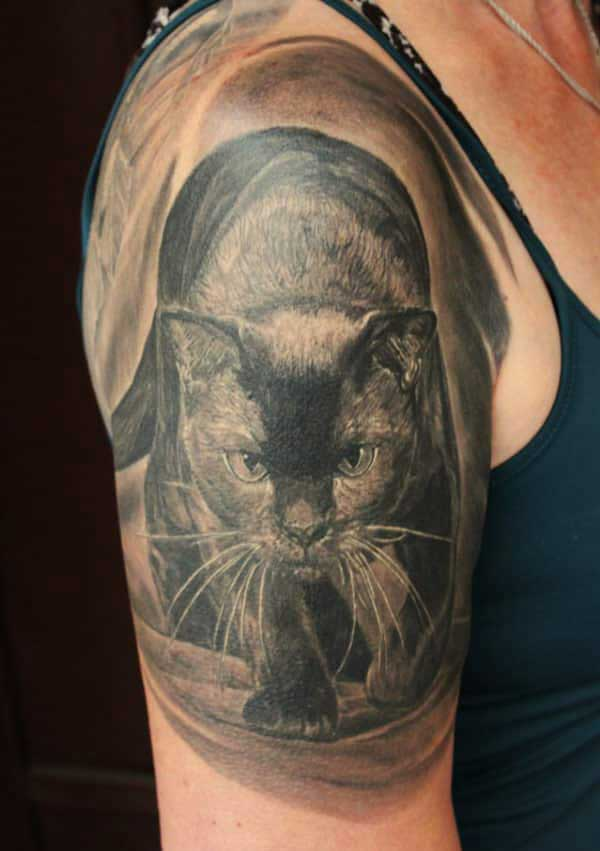 Cat tattoo design idea for girls on shoulder