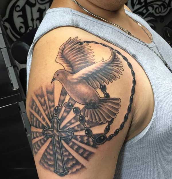 Cross and dove tattoo design idea for the men shoulder