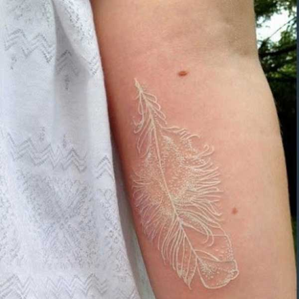 white feather tattoos