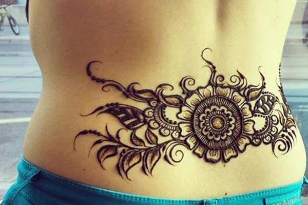f123e3e917366 Henna Mehndi tattoo designs idea for lower back - Tattoos Art Ideas