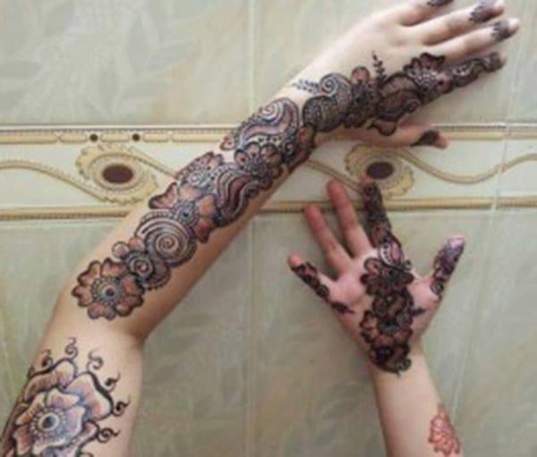 Full arm Mehndi tattoo designs idea
