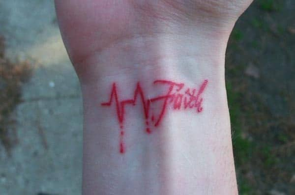 Heartbeat Faith tattoo on a girl's hand is a symbol of love