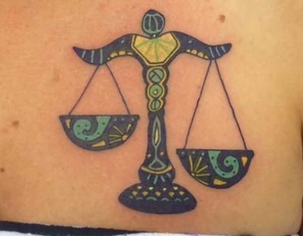 This upper chest Libra scale tattoo design idea for beautiful ladies
