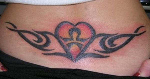 The Lower back tattoo design idea for the ladies with red and yellow shade