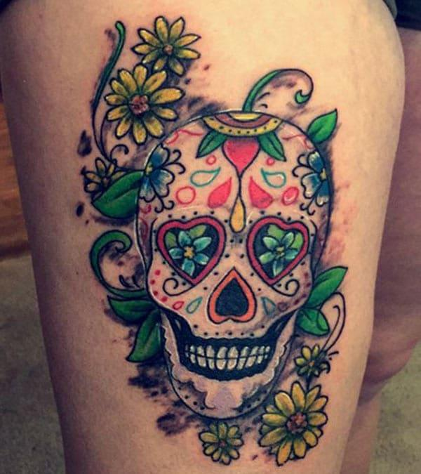 The color Sugar skull tattoo on down side of female thigh