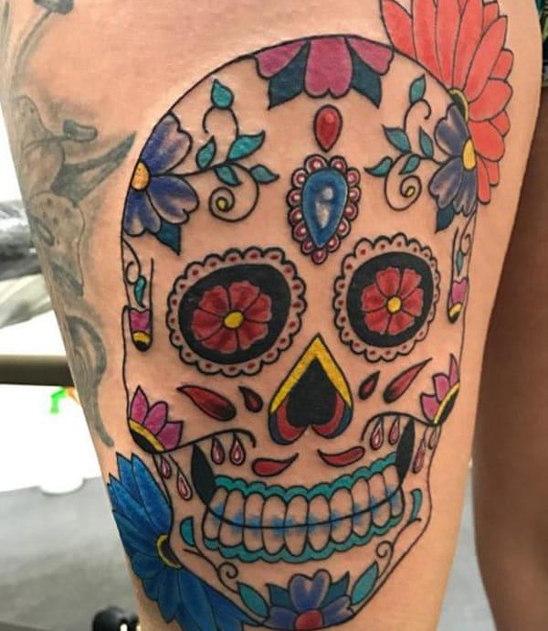 The best Red, Blue and green sugar skull tattoo on female leg