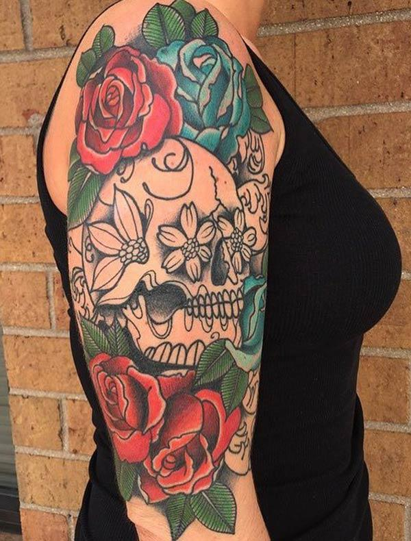 The Best sugar skull tattoo with full of flowers on girl's arm