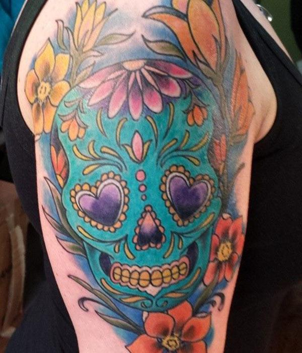 The macho arm sugar skull tattoo for girls