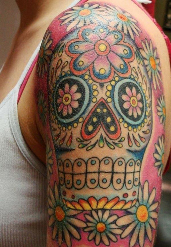 The best sugar skull tattoo with a story like design for a girl's arm