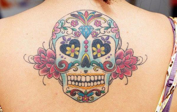 Best and short sugar skull tattoo on a girl's back point