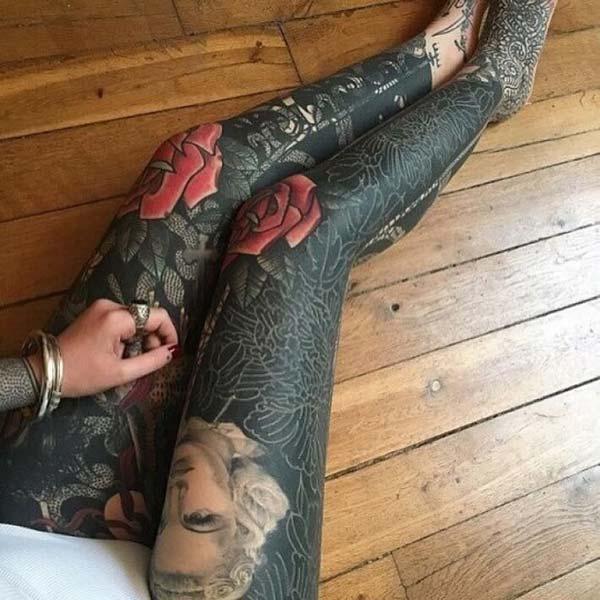 An eye-catchy full leg tattoo for Women