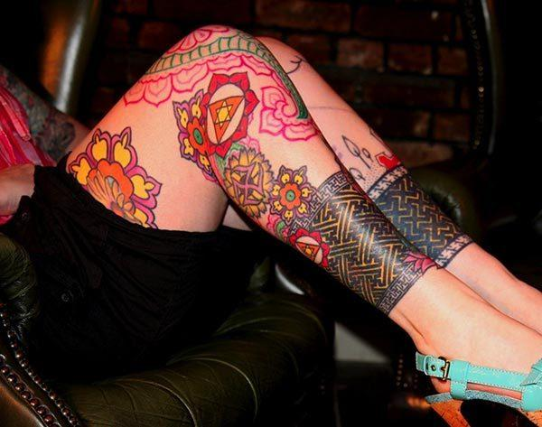 A vibrant appealing full leg tattoo for girls