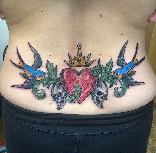 A catchy lower back tattoo for ladies