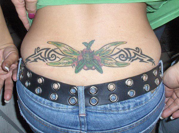 A lovely lower back tattoo for Girls and women