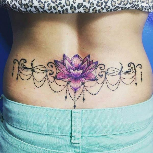 A graceful lower back tattoo design for women