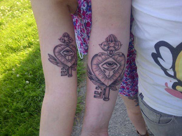 An amazing matching tattoo design on upper arm for girls