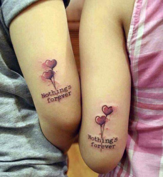 A lovely matching tattoo design on upper arm for ladies