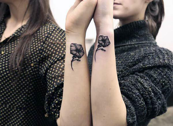 A striking matching tattoo design for girls on wrist