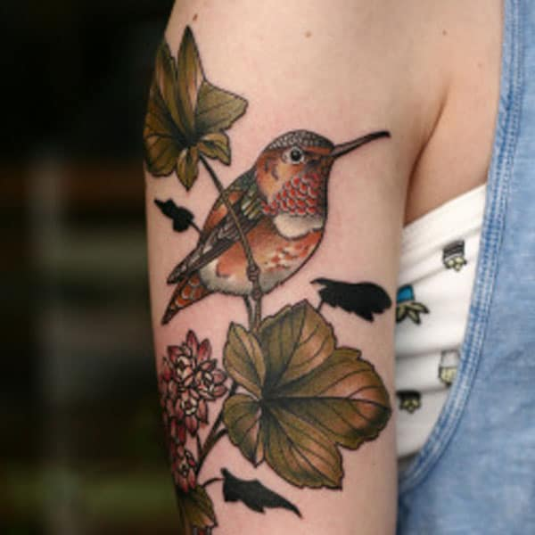 vogel tattoo op arm