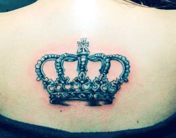 girl crown tattoo on back