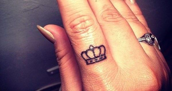 crown tattoos on finger