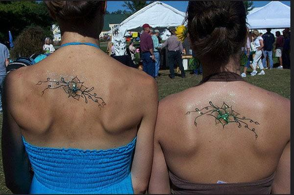 back sister tattoos